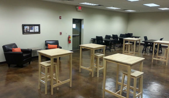 The industry studios cowork space work and meeting tables and desks